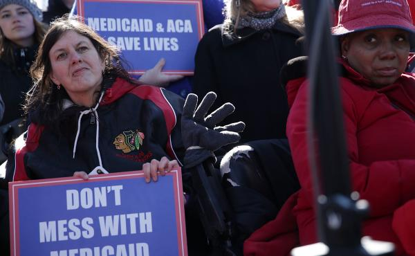Health care activists rallied in front of the U.S. Capitol on March 22, 2017, to protest Republican efforts that would have dismantled the Affordable Care Act and capped federal payments for Medicaid patients. The Republican congressional bills, part of t