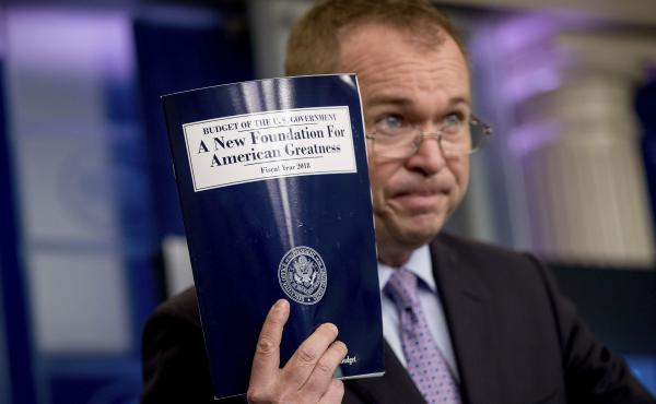 Budget Director Mick Mulvaney holds up a copy of President Trump's proposed fiscal 2018 federal budget at the White House on Tuesday.