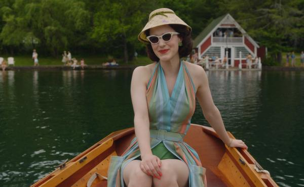 "In the second season of The Marvelous Mrs. Maisel, Midge (Rachel Brosnahan) visits the Catskills. Costume designer Donna Zakowska says this outfit ""in the boat with a funny lampshade hat"" was among her favorites."
