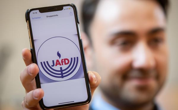 Leon Hakobian shows on his mobile phone a preliminary draft of a logo for a new Jewish grouping within Germany's far-right Alternative for Germany party, during the Jewish group's founding event on Oct. 7 in Wiesbaden, a city in Germany's western state of