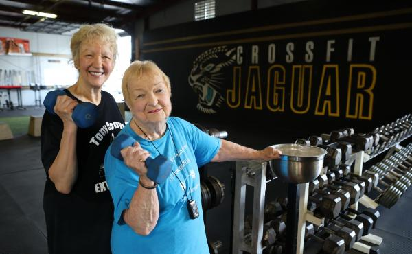 Edith Murway (right) with her friend Carmen Gutworth at the gym. Gutworth convinced Murway to join her at the gym, which is how at 91 she got hooked on lifting.