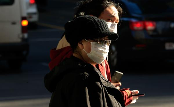 People in Melbourne, Australia, wearing face masks on Thursday. Victoria has recorded 317 new cases of coronavirus in 24 hours, the highest daily total recorded in the state since the pandemic began.
