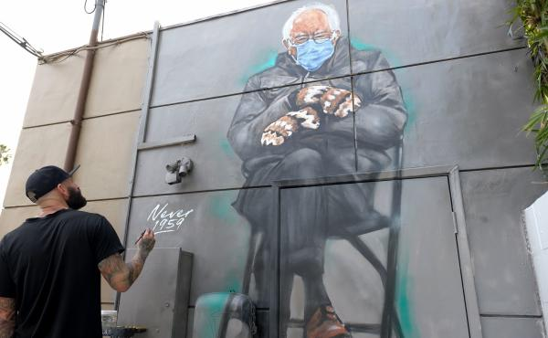 Artist Jonas Never (@never1959) applies finishing touches to his mural of Sen. Bernie Sanders in Culver City, Calif., on Jan. 24. Standing out in a crowd of glamorously dressed guests, Sanders showed up for the presidential inauguration in a heavy winter