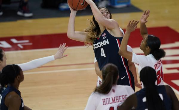 Connecticut guard Saylor Poffenbarger (4) is defended by St. John's guard Danaijah Williams (24) and forward Cecilia Holmberg (11) during the fourth quarter of an NCAA college basketball game in New York last month. The women's NCAA championship begins Su