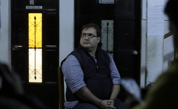 Javier Duarte, the former governor of the Mexican state of Veracruz, sits handcuffed following his arrest in Panajache, Guatemala, on Saturday.