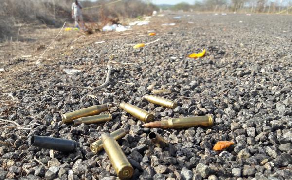 Spent bullet casings litter a road after authorities reported a gunbattle outside Mazatlan, Mexico, in July 2017, a year marked by the highest homicides in at least decades.