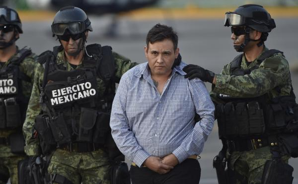 The alleged leader of the Zetas drug cartel, Omar Trevino Morales, is taken under custody to be presented to the press at the Attorney General Office's hangar at the airport in Mexico City, on March 4. Mexican authorities captured Trevino Wednesday, deali