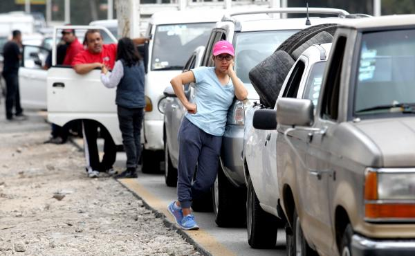 Motorists wait in line for hours to buy gasoline at a Pemex service station in Guadalajara, Mexico, on Sunday. The Mexican president temporarily closed some of the state oil company's pipelines, in a bid to wipe out rampant fuel theft.