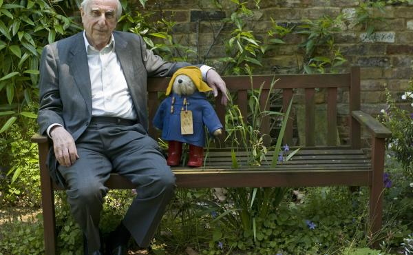 Michael Bond sits with a Paddington Bear toy in 2008. Bond died Tuesday, according to his publisher, nearly six decades after his beloved character first appeared in print.