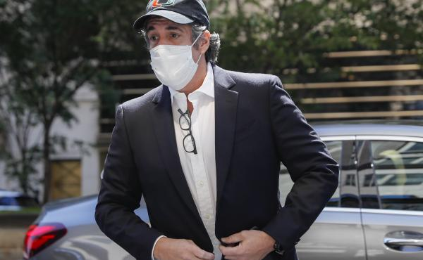 Michael Cohen arrives Thursday at his Manhattan apartment after being released from federal prison.
