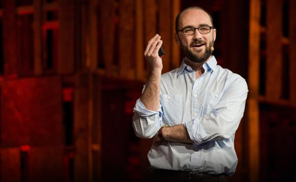 Michael Stevens speaks on the TED Stage in La Quinta, California.