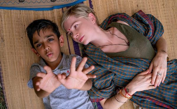In After the Wedding, Michelle Williams plays Isabel, who runs an orphanage in India. Vir Pachisia plays Jai, the boy beside her.