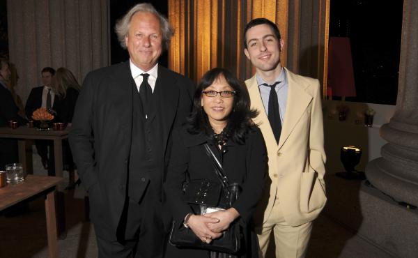 Michiko Kakutani (center) stands flanked by Vanity Fair editor Graydon Carter and his son Ash at a party in New York City in 2008.