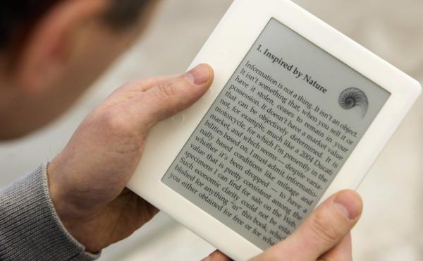 A man reads a book on his e-book reader device. In July, Microsoft will be deleting its e-book library and ceasing all e-book sales.