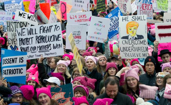 Demonstrators with pink hats begin to gather in Washington for the Women's March on Jan. 21, 2017, the first full day of Trump's presidency. Now, many women have turned that energy into elections.