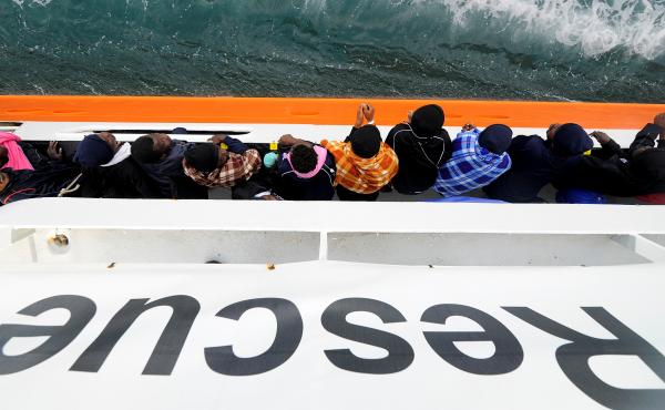 Migrants wait to disembark from the rescue ship Aquarius in the Sicilian harbor of Catania, Italy, on May 27. This past weekend the ship picked up more migrants, but was turned away from ports in Sicily and the nearby country of Malta. Now it will head fo