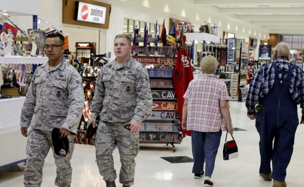 Service members and civilians walk through a store on Offutt Air Force Base in Nebraska in 2017. The Army and Air Force Exchange Service, which oversees military retail facilities, recommended this week that stores show sports instead of news on their com