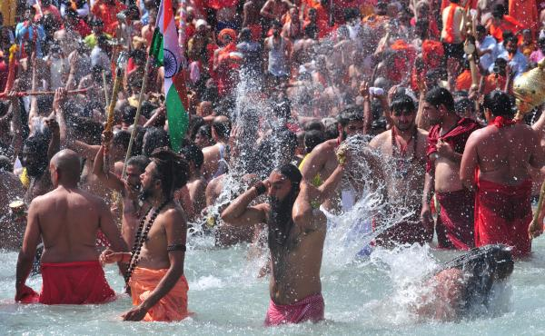 Men take a holy dip in the Ganges River on the occasion of first royal bath of Shivratri festival during Maha Kumbh Festival in Haridwar, India.