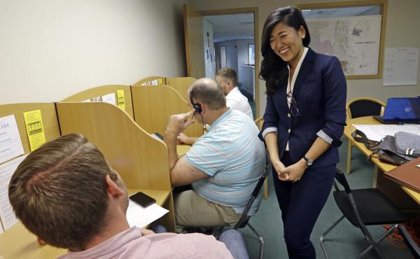 Jinyoung Lee Englund, the Republican candidate for 45th district Senate seat in Washington, talks with volunteers at her campaign headquarters in Woodinville, Wash. The race has attracted national attention and money because Englund's loss would give Demo