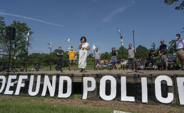 """Alondra Cano, Minneapolis City Council Ward 9 representative, spoke to community members at """"The Path Forward"""" meeting at Powderhorn Park, where she joined eight of her colleagues in announcing plans to disband the city police department."""