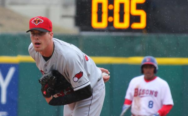 Alex Meyer, then a member of the minor-league Rochester Red Wings, watches for a signal from his catcher as a 20-second pitch clock counts down in 2015. On Wednesday, Minor League Baseball announced it will shave five seconds off that clock when there are