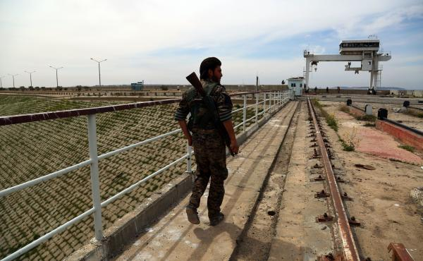 Central Command says an errant coalition strike killed 18 fighters from the Syria Democratic Forces. A member of the U.S.-backed SDF, made up of an alliance of Arab and Kurdish fighters, inspect the Tabqa dam on March 27.