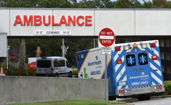 An ambulance arrives at the emergency department at AdventHealth hospital in Orlando in late July. Florida is one of several states seeing disappearing hospital capacity as COVID-19 cases surge.