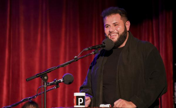 Comedian Mo Amer appears on Ask Me Another at the Bell House in Brooklyn, New York