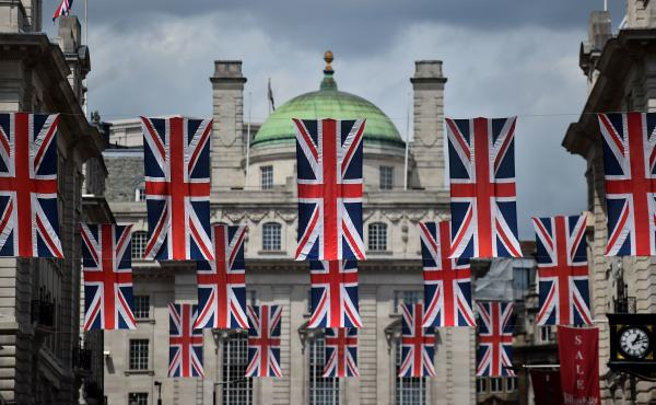 Union flags fly as banners across a street in central London on Tuesday. EU leaders attempted to rescue the European project and Prime Minister David Cameron sought to calm fears over the U.K.'s vote to leave the bloc as ratings agencies downgraded the co