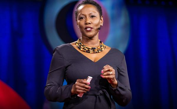 Monique Morris on the TED stage.