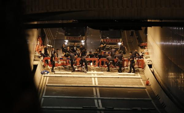 Hong Kong police dismantle barricades previously set up by pro-democracy protesters from the Occupy Central movement in Admiralty District of Hong Kong on Wednesday.