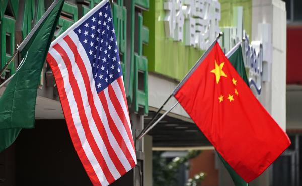 The US (L) and Chinese flags are displayed outside a hotel in Beijing on May 14, 2019.