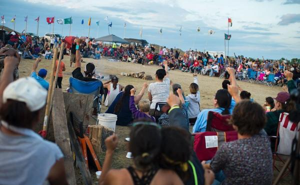 Members of the Standing Rock Sioux tribe and their supporters gather in a circle to hear speakers and singers at a protest encampment last month near Cannon Ball, N.D.