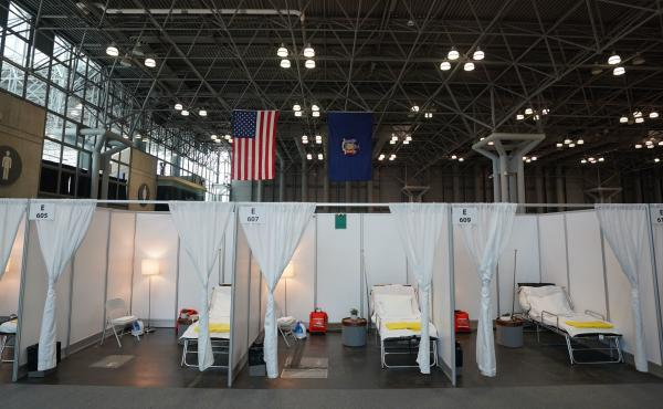 Authorities are setting up a temporary hospital with 1,000 beds at the Jacob K. Javits Center on Friday in New York City. The city is bracing for an overwhelming tide of patients, as its number of confirmed cases continues to rise.