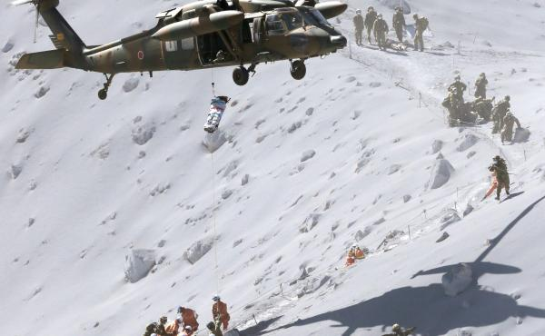 A hiker is lifted by a rescue helicopter at Mt. Ontake, which erupted Saturday. The volcano straddles the Nagano and Gifu prefectures in central Japan.