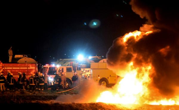 Firefighters work to extinguish a massive blaze triggered by a leaking pipeline in Tlahuelilpan, Mexico on Friday night. At least 66 people were killed.