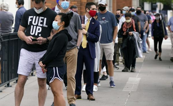 Voters line up at the American Airlines Center during early voting in mid-October in Dallas.