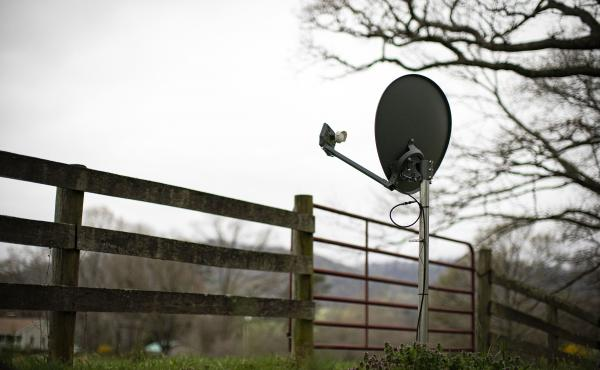 A Viasat internet satellite dish is seen in the yard of a house in Madison, Va., on March 31.
