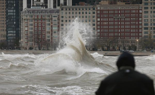 The remnants of Hurricane Sandy churn up Lake Michigan in Chicago in 2012. Flood risk in the city is increasing as climate change drives more extreme rain, and renters face greater financial peril than homeowners. More than half of Chicagoans are renters,