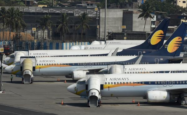 Jet Airways planes are grounded at Chhatrapati Shivaji Maharaj International Airport in Mumbai, India, on Thursday after the airline announced it was shutting down because of financial problems.