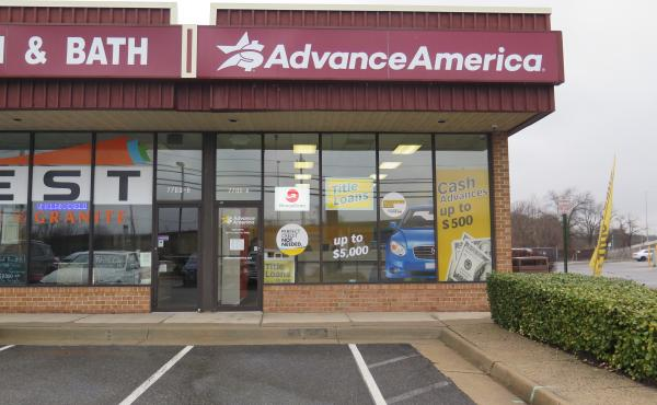 Ads promise cash in the form of payday loans at an Advance America storefront in Springfield, Va. The Consumer Financial Protection Bureau is seeking to rescind a proposed rule to safeguard borrowers from payday lenders.