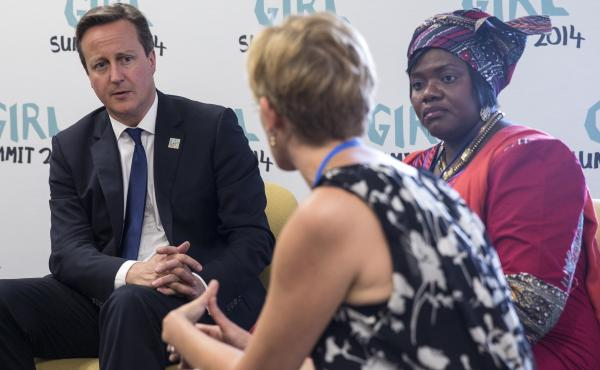 British Prime Minister David Cameron speaks with campaigners against female genital mutilation at the Girl Summit in London in July.