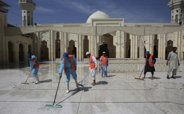 Volunteers disinfect a mosque ahead of prayers during the Muslim holy month of Ramadan in Peshawar, Pakistan, on Friday.