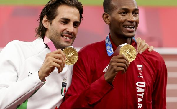Gold medalists Gianmarco Tamberi of Italy and Mutaz Essa Barshim of Qatar shared the podium after the men's high jump at the Tokyo 2020 Olympic Games at Olympic Stadium.