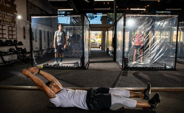 "Peet Sapsin directs clients inside custom built ""Gainz Pods"", during his HIIT class, (high intensity interval training), at Sapsins Inspire South Bay Fitness, Redondo Beach, California, Wednesday, June 17, 2020."