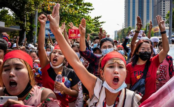 People make three-finger salutes during an anti-coup march on Saturday in Yangon, Myanmar.