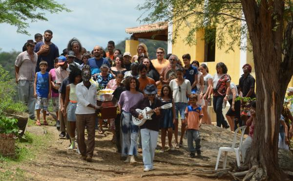 Mourners gather for a heartfelt burial ceremony in the Brazilian film Bacurau.
