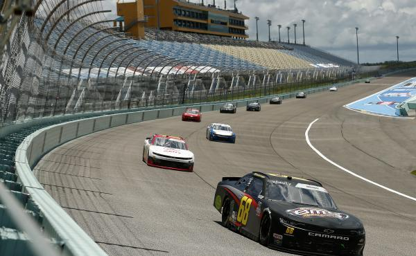 Brandon Brown leads a pack of cars during the NASCAR Xfinity Series Contender Boats 250 at Homestead-Miami Speedway Sunday. The Cup Series race later on Sunday will be the first with fans in the stands since March.