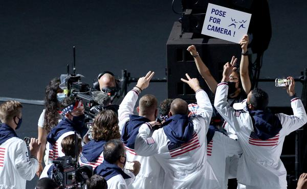 Members of the U.S. team pose for NBC cameras during the closing ceremony on Sunday.
