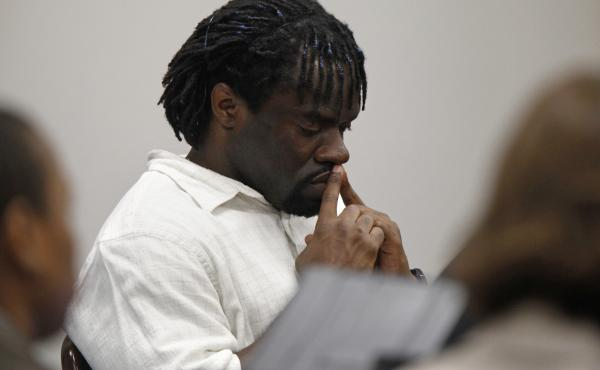 Death row inmate Marcus Robinson listens in 2012 as a judge concludes that racial bias played a role when he was sentenced to death. Robinson was resentenced to life, but he was sent back to death row years later after the state's Racial Justice Act was r